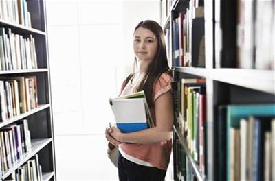 stock-photo-portrait-of-female-student-with-books-in-library-82762985
