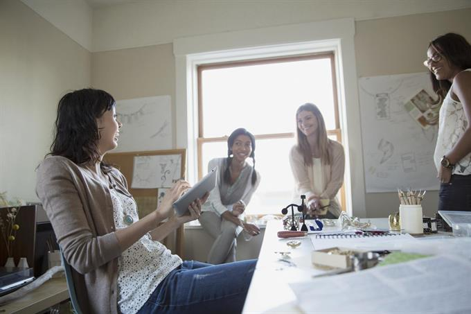 stock-photo-professional-female-jewelry-artists-having-discussion-in-home-office-83062197